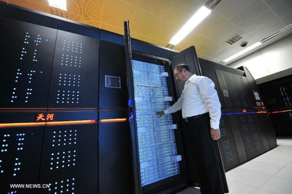 Tianhe-2, the fastest supercomputer in the world as of today, contains 32,000 Intel Ivy Bridge chips and 48,000 Intel Xeon Phi chips. Photo by Xinhua/Long Hongtao, via China Radio International's English Service.